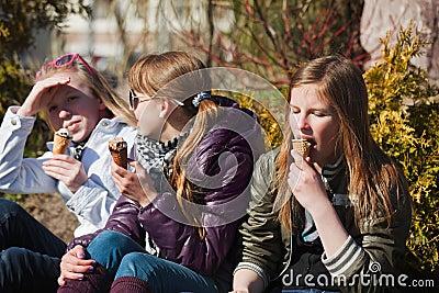 Teenage girls eating an ice cream
