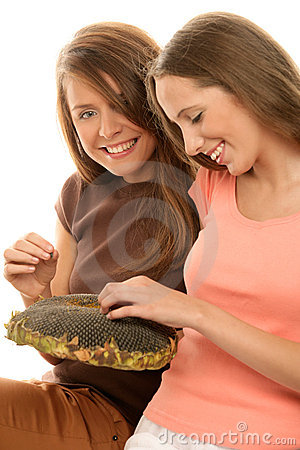 Free Teenage Girls Eating Sunflower Seeds Stock Images - 11446654