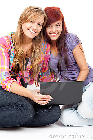 Teenage girls friends with laptop