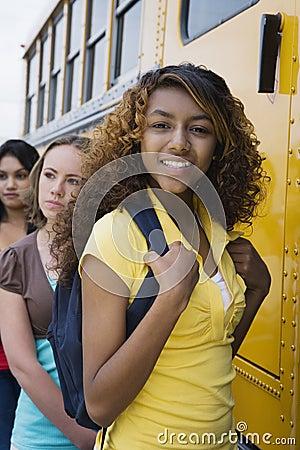 Teenage Girls Getting On School Bus