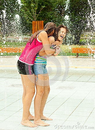 Free Teenage Girls Having Fun In The Towns Fountain Stock Images - 26002684