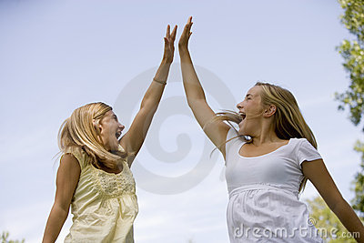 Teenage girls High-Five