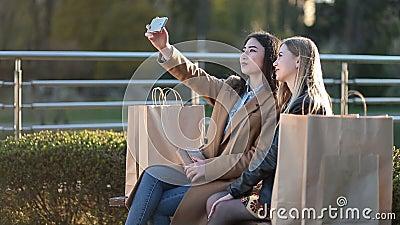 Teenage girls making self portrait with phone stock footage