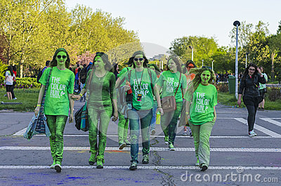 Teenage girls painted with green powder Editorial Photography