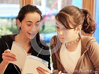 Teenage girls reading a book