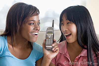 Teenage Girls Talking On Telephone