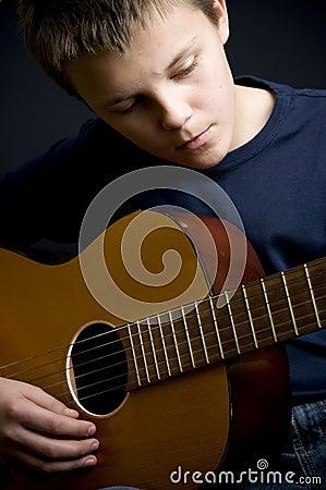 Free Teenage Guitar Player Stock Photos - 11707413