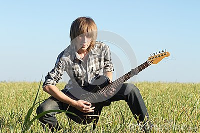 Teenage guitar player posing