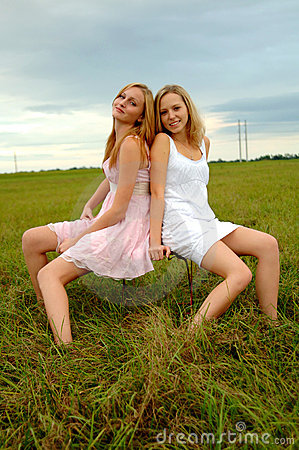 Teenage sisters in field