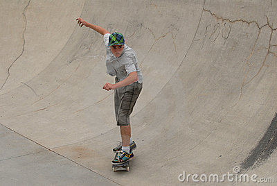 Teenage skateboarder in pipe