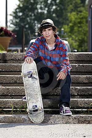 Free Teenage Skateboarder Sitting On Stairs Royalty Free Stock Photos - 10913428