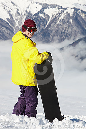 Teenage Snowboarder Admiring Mountain View