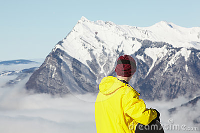 Teenage Snowboarder Admiring Mountain View