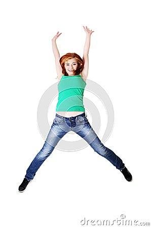 Teenage student jumping.