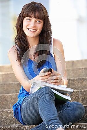 Teenage Student Sitting On College Steps