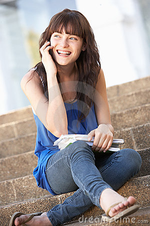 Teenage Student Sitting Outside On College Steps