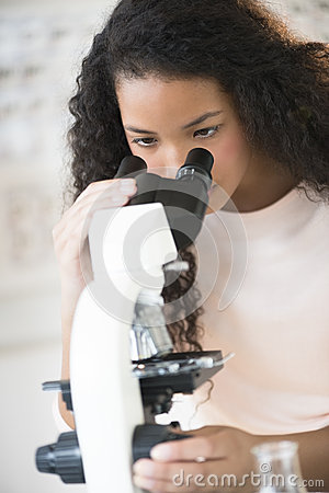 Teenage Student Using Microscope