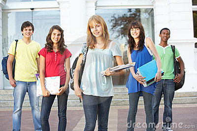 Teenage Students Standing Outside College Building