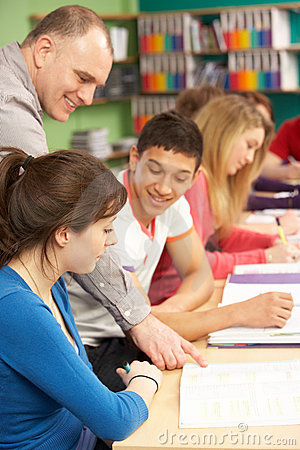 Free Teenage Students Studying In Classroom With Tutor Royalty Free Stock Photos - 18037018