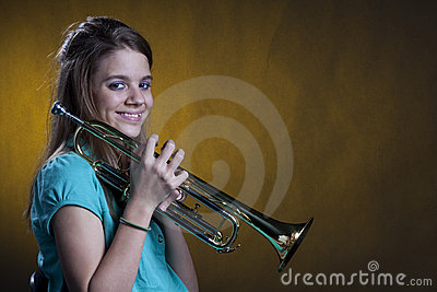 Teenage Trumpet Player On Yellow