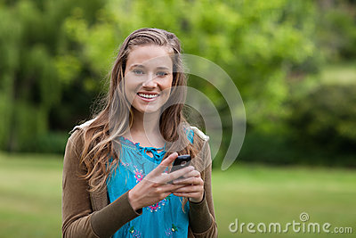Teenage using her cellphone while sending a text