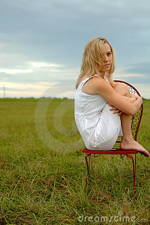 Teenager alone in field