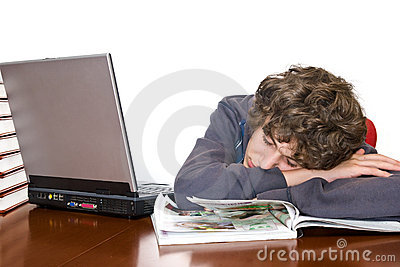Teenager asleep studying for examination