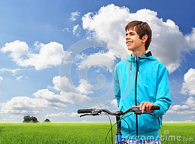 Teenager with Bicycle in Field
