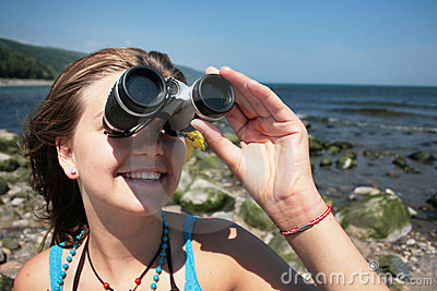 Teenager with binocular