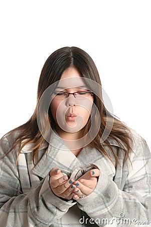 Teenager Blowing