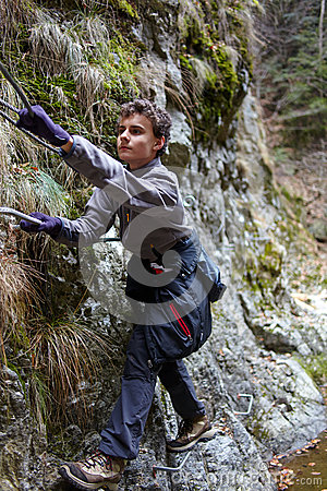 Teenager boy climbing