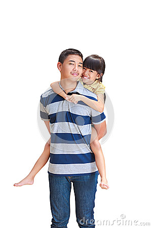 Teenager boy giving little girl  piggyback ride,