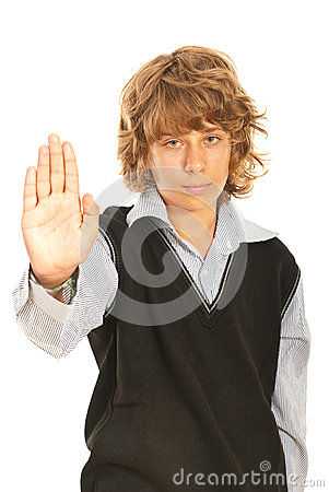 Teenager boy showing stop hand