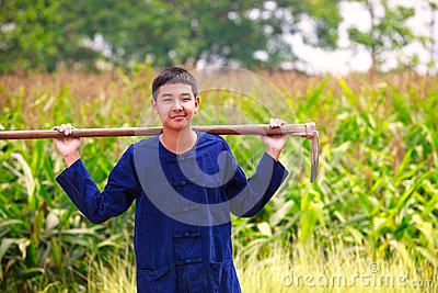 Teenager boy in thailand ss agriculturist dress