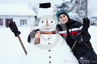 Teenager building a snowman