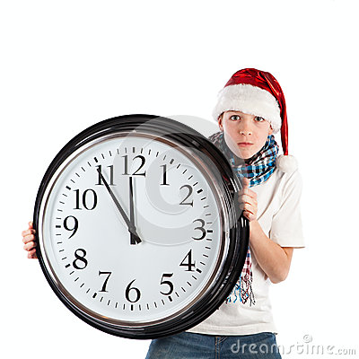 Teenager in cap of Santa Claus and large clock