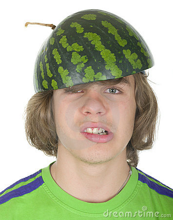 Teenager in a cap from a water-melon