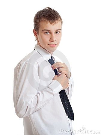 The teenager corrects a tie