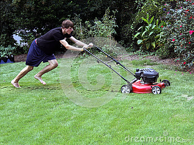 teenager cutting grass
