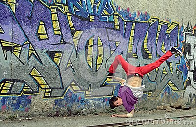 Teenager dancing break dance on the street