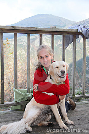 Teenager and dog after long hike