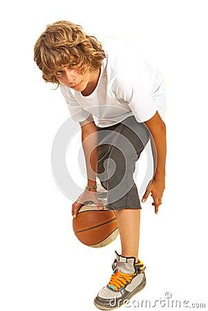 Teenager dribbling basketball