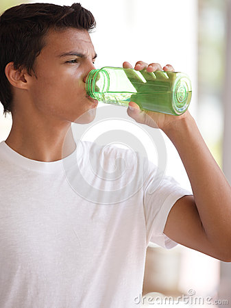 Teenager drinking water