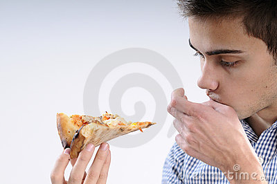 Teenager eating pizza