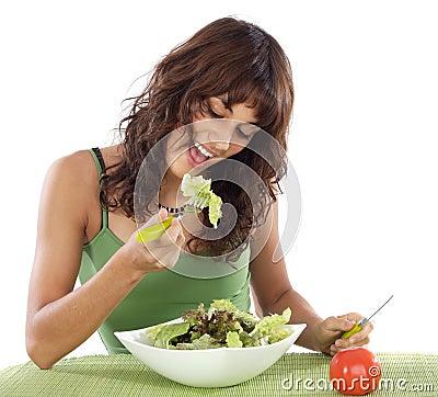 Teenager eating salad