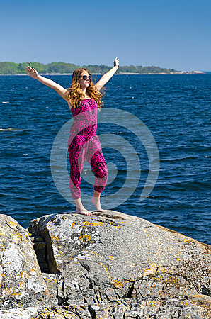 Teenager feel freedom on a sea coast
