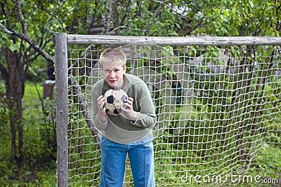 Teenager with football ball
