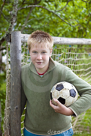 Teenager with football ball