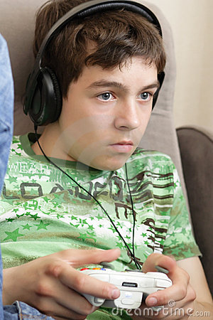 Teenager with game pad