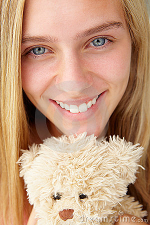 Teenager girl close up with teddy bear